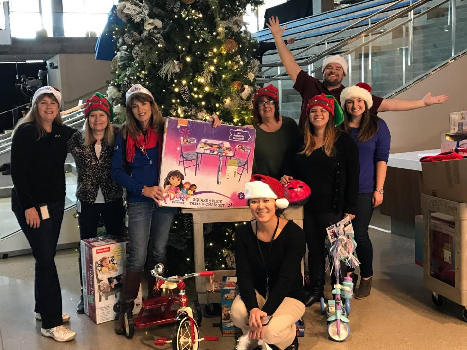 Santa's Helpers -- Employees give Santa a helping hand by collecting gifts for underprivileged kids and families in Silicon Valley. It's one of the many holiday-time philanthropic events that occur across Intuit.