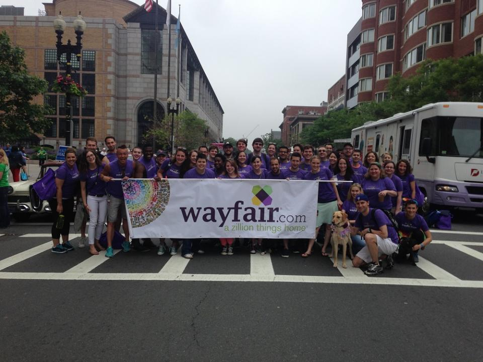 Wayfair employees join together to participate in Boston's Gay Pride Parade.