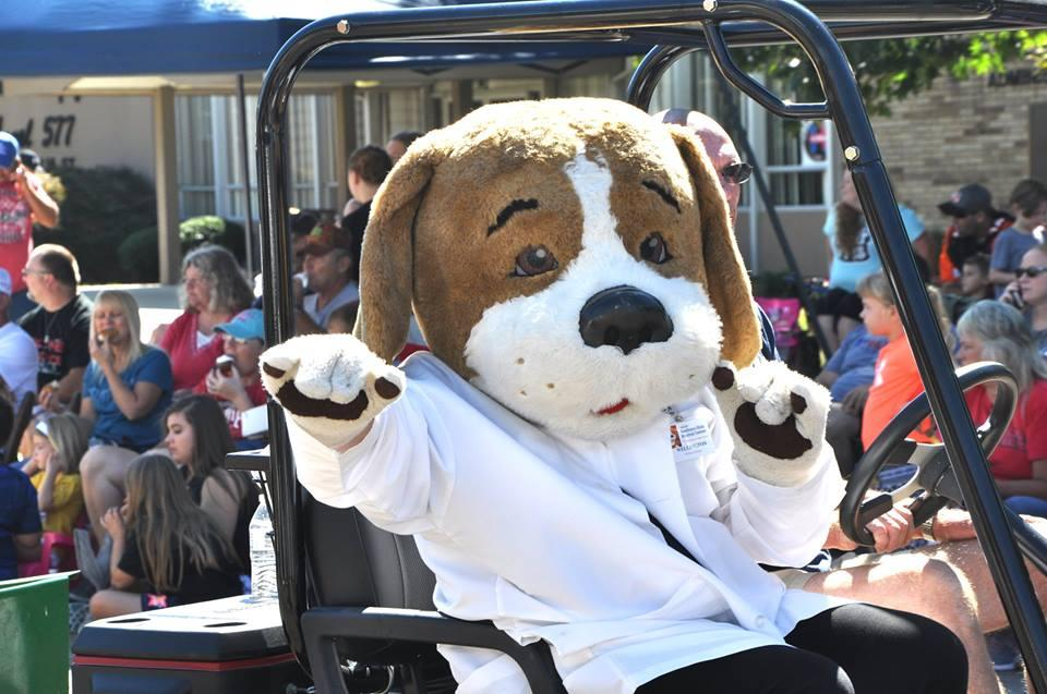 Wellington the Wellness Hound, SOMC mascot, entertains the crowd at the Portsmouth River Days parade.
