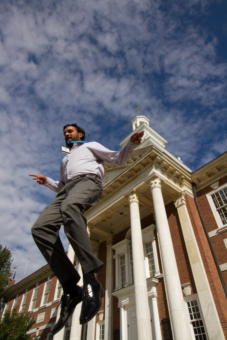 Customer Service Vice President Sapan Patel gets a jump on the day in front of Founders Hall, designed after Independence Hall in Philadelphia. Beyond bricks and mortar, our founders left us strong values, chief among them to be Above all in Service.