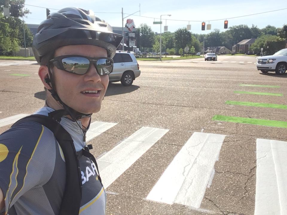 Employee bikes to work in Barge cycling jersey