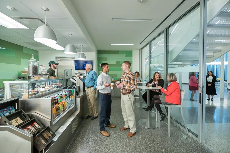Employees connecting over coffee at The Battery, our on-site coffee shop