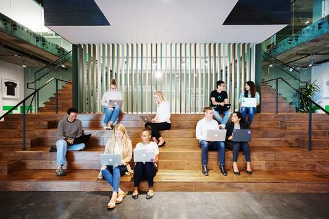 Employees meeting in the open workspace in the San Mateo HQ