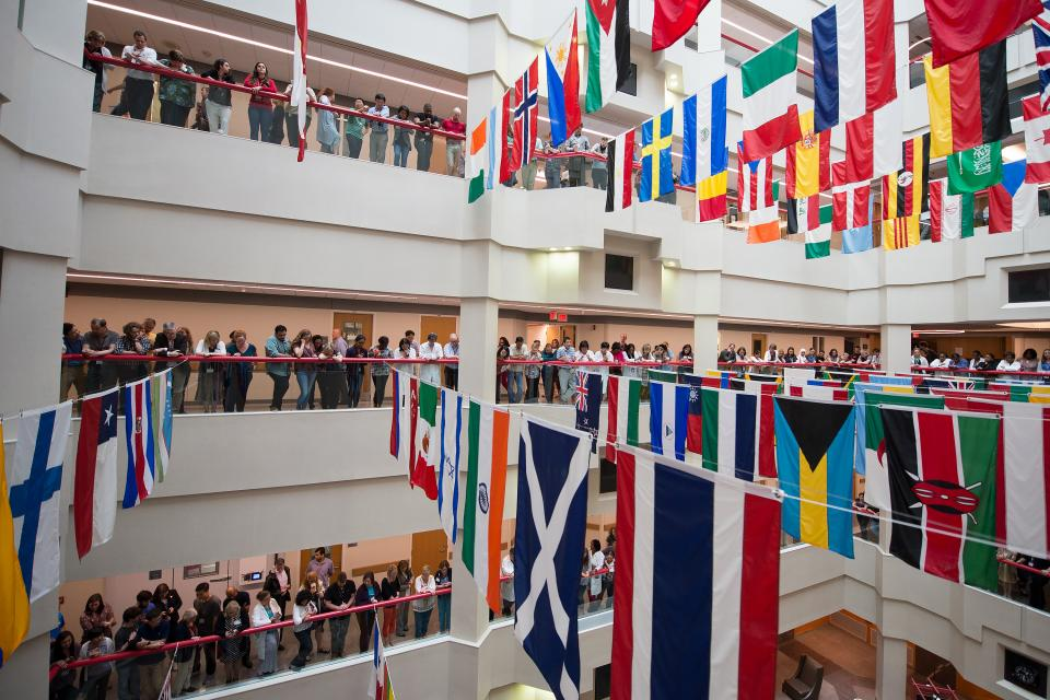 St. Jude employees lined the balconies of our Danny Thomas Research Center to listen to the public launch of St. Jude Global. The announcement took place beneath more than 100 flags representing the homelands of St. Jude employees.