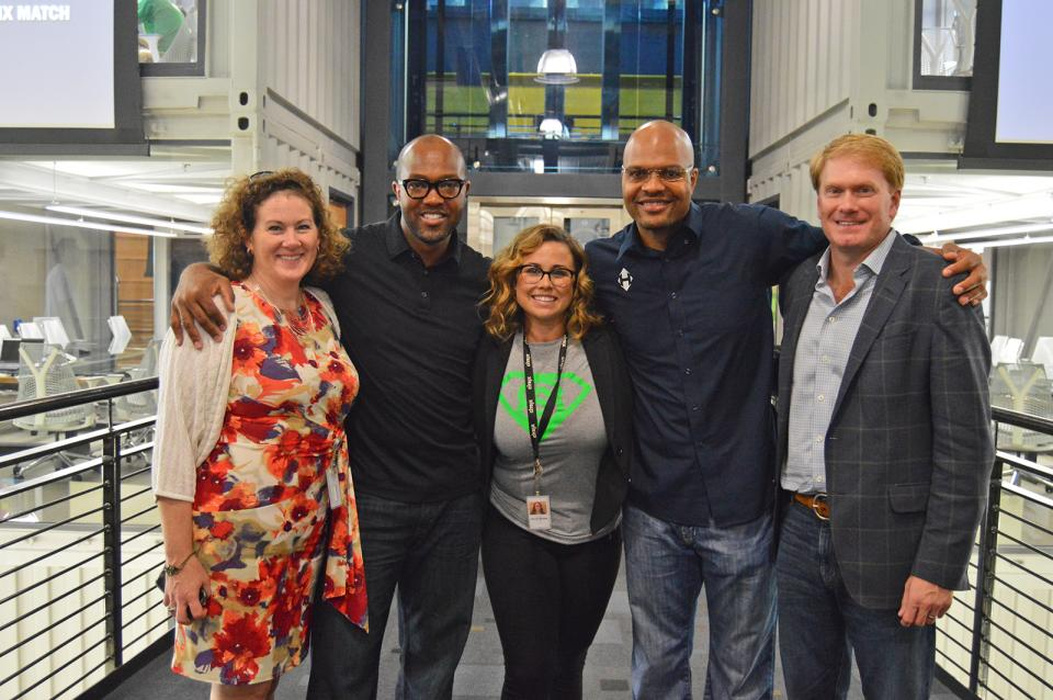 In our Raleigh office with former NFL football players, Terrence and Torry Holt, following our participation in their charity football event