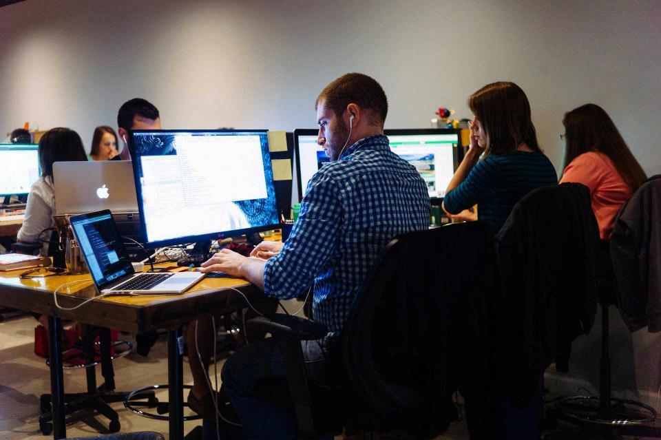 IMPACT Employees Working
