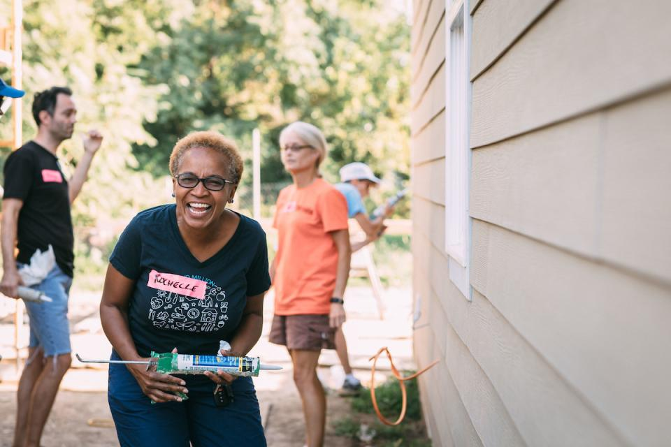 An employee giving back with Habitat Humanity in Indianapolis