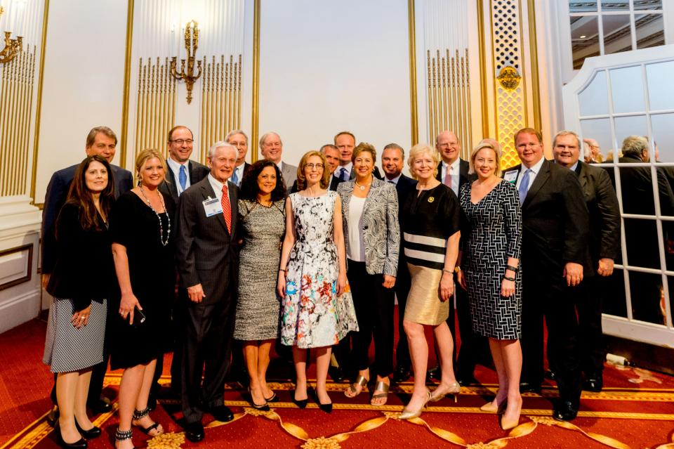 Linda Klein (center) is surrounded by coworkers and colleagues after being named President of the American Bar Association.