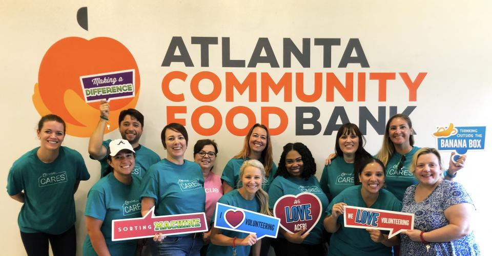 Alpharetta, Ga office volunteering at the Atlanta Community Food Bank where they packed over 15,000 lbs. of food!