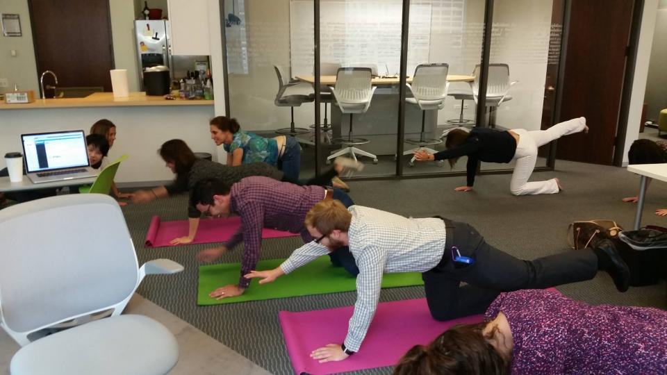 Retrofit yogis in action during an all company meeting.