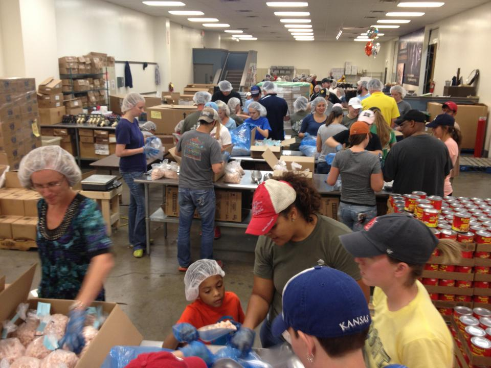 Employees and their families volunteer together at the local food bank.