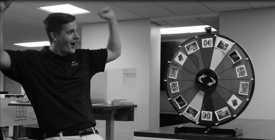 Jake Becker celebrates after spinning the employee referral prize wheel
