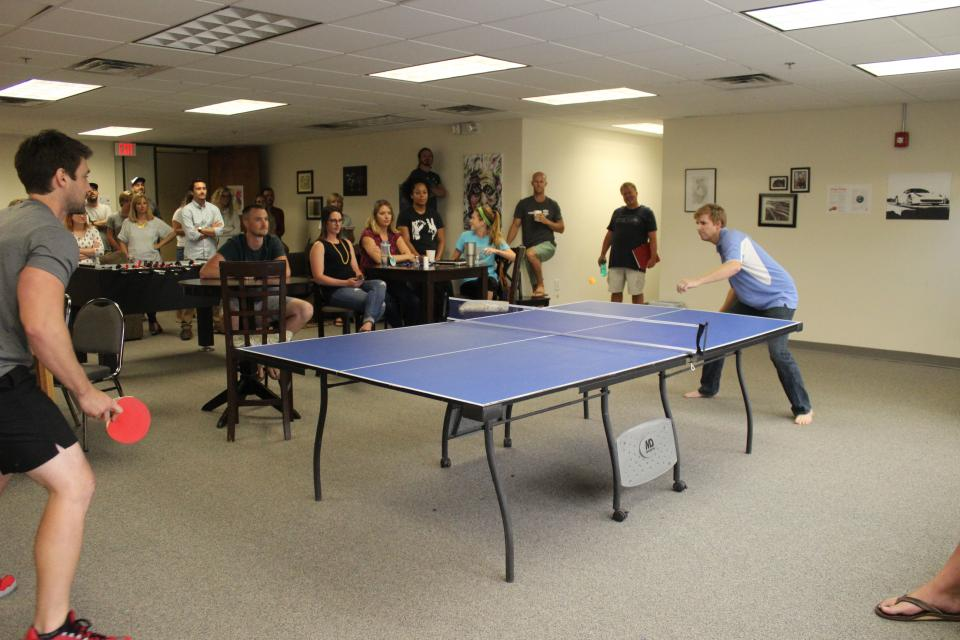 The finalists of our Home Office Ping Pong Tournament battling it out!