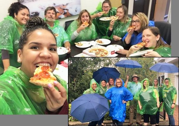 Our Florida Team battling the storm with pizza & ponchos!
