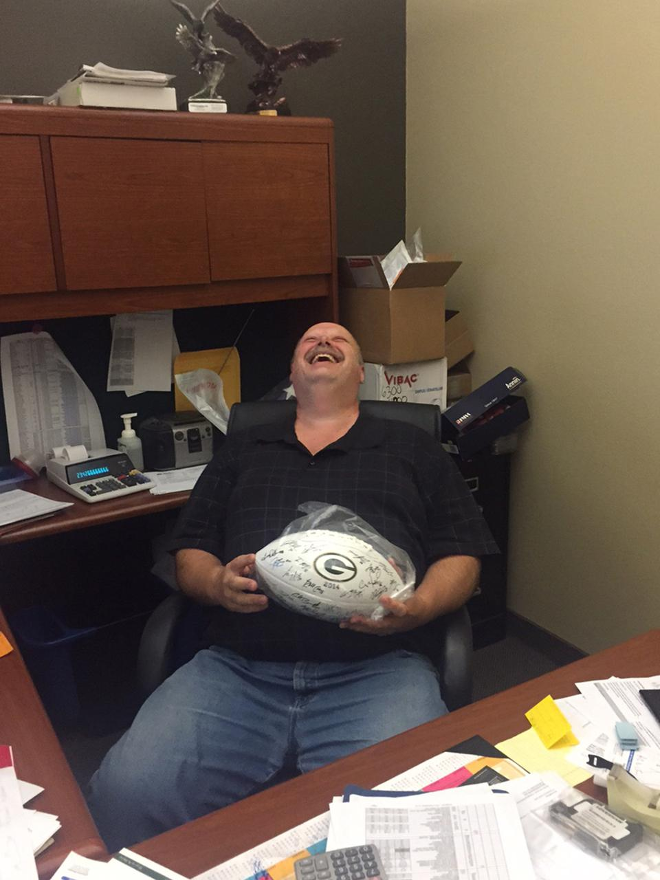 Wes wins an autographed Packers football.