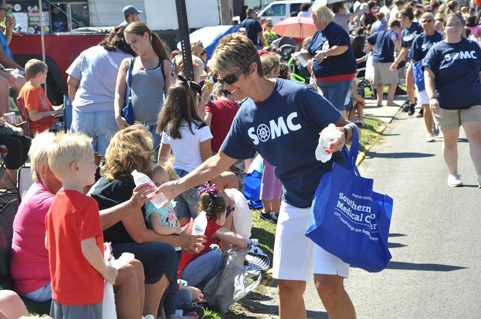 Over 80 SOMC employees passed out bottled water during a hot September parade route.