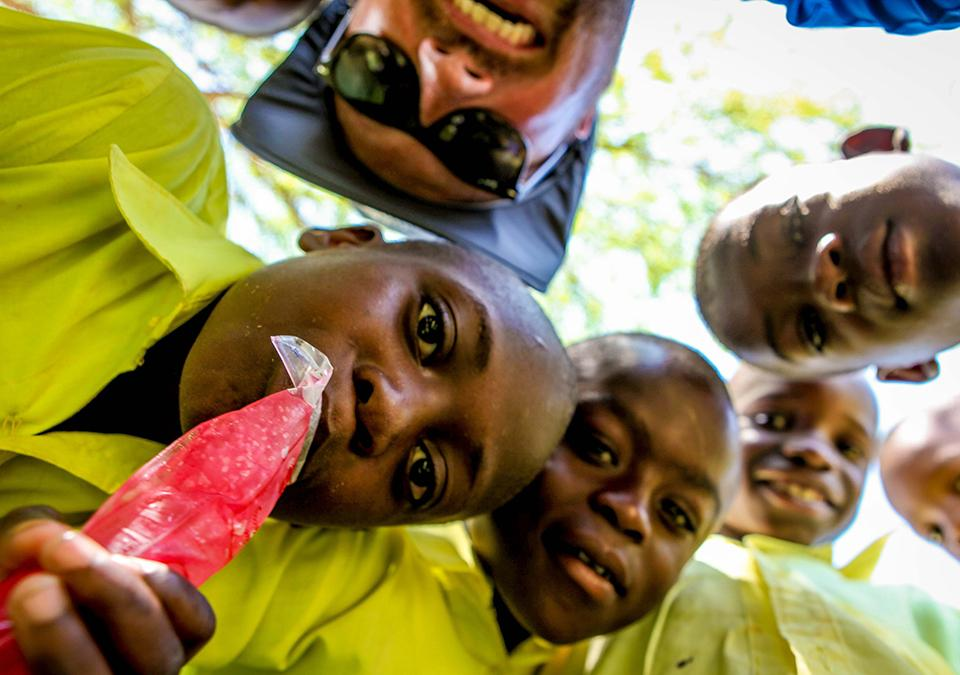 Ryan takes a selfie with students on his Haiti trip