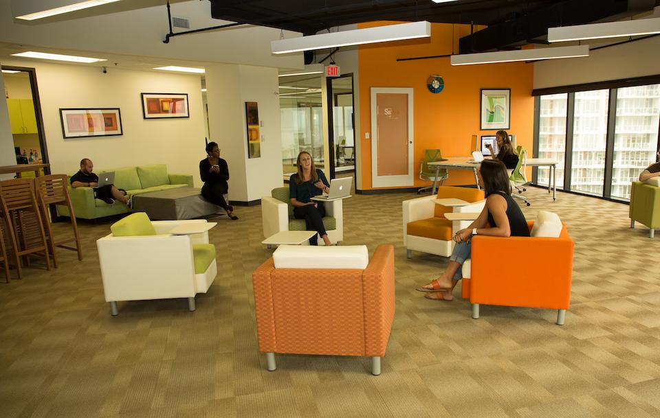 Squaremouth's offices are completely open, with couches and lounge chairs, and no cubicles.