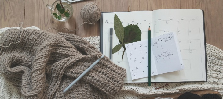 Knitting and journal opened on desk