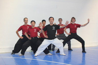 Tai Chi Grandmaster & Students Sporting Custom Ink! T-Shirt Photo