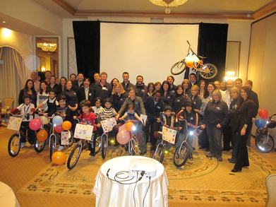 Sales Team Builds Bikes For Kids.  T-Shirt Photo