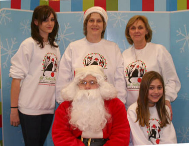 The Cat Tales Volunteers With Santa Claws T-Shirt Photo