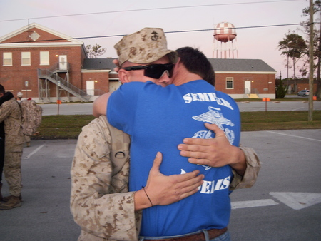 A Father Welcoming His Son Home From The War.  T-Shirt Photo