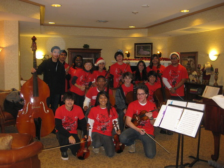 Group Pose After Performance At Memory Care Home T-Shirt Photo