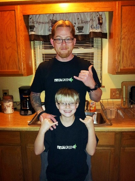 "Two Generations Of ""Ninjas"" Growing Food Together.  T-Shirt Photo"