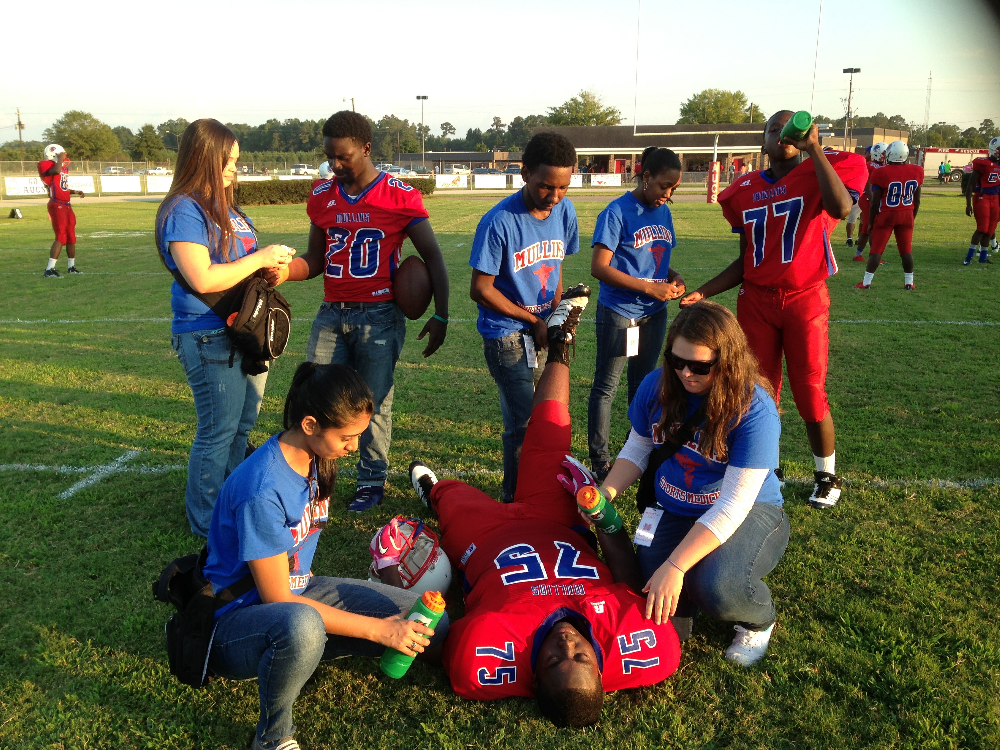 8dada899ce0a Student Athletic Training Aides Looking Great While Helping The Football  Team T-Shirt Photo