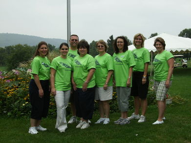 Volunteers At Our Annual Charity Golf Tournament T-Shirt Photo