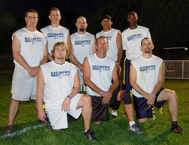 Sig News Flag Football Team T-Shirt Photo
