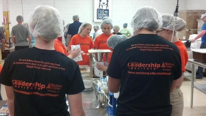 Leading By Serving With Feed My Starving Children T-Shirt Photo