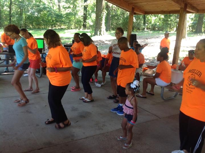 Miller's Rockin' That  Orange T-Shirt Photo