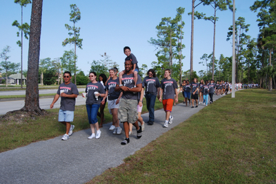 Team Tim From Palm Beach Central Hs Leads The Cf Walk. T-Shirt Photo