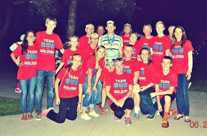 Team Holding T-Shirt Photo