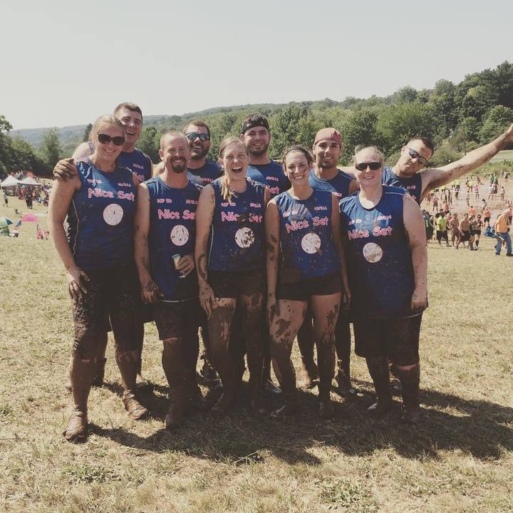 Team Nice Set At The 29th Annual Mud Volleyball Tournament T-Shirt Photo
