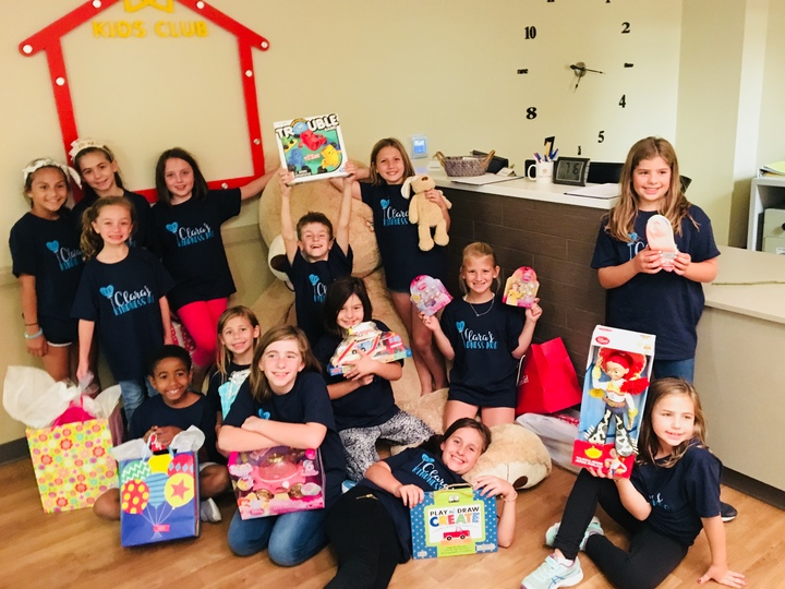 Clara's Kindness Mob Delivering Gifts To The Children's Home T-Shirt Photo
