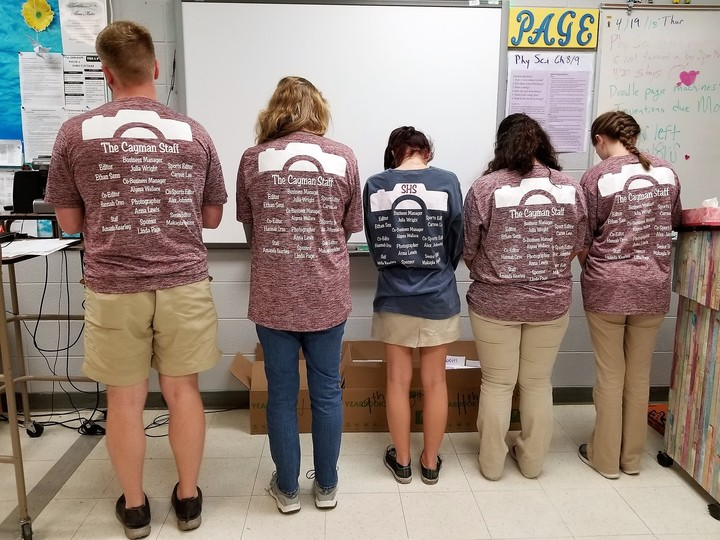 Yearbook Staff Shows Off Their Design T-Shirt Photo