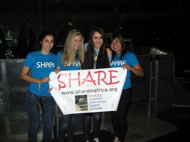 "Miley Cyrus Says ""Share Is Awesome!"" T-Shirt Photo"