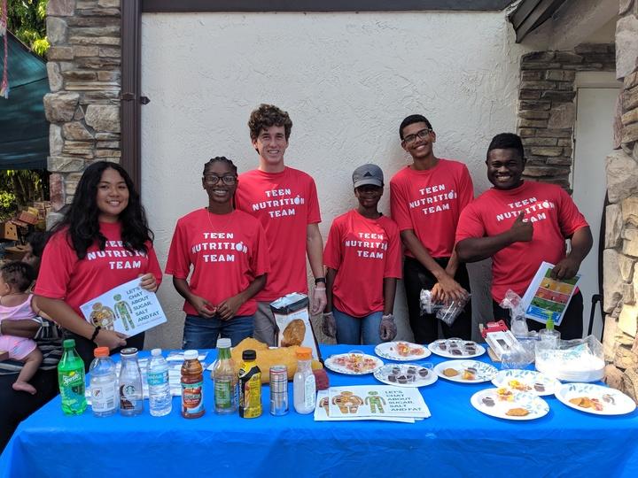 Teen Nutrition Team Tackles Tough Topics T-Shirt Photo