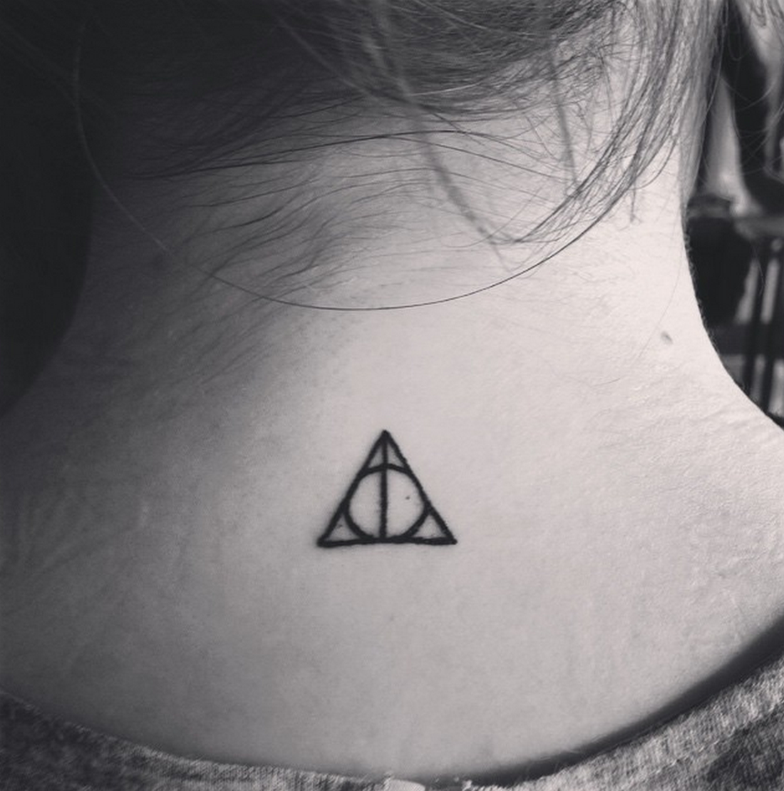 19 tiny tattoos that will make you want to get inked tiny deathly hallows symbol buycottarizona
