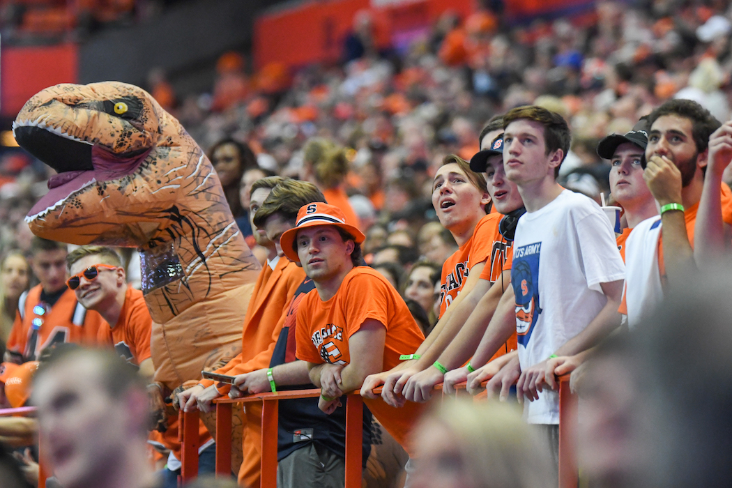 Syracuse fans react during a football game.