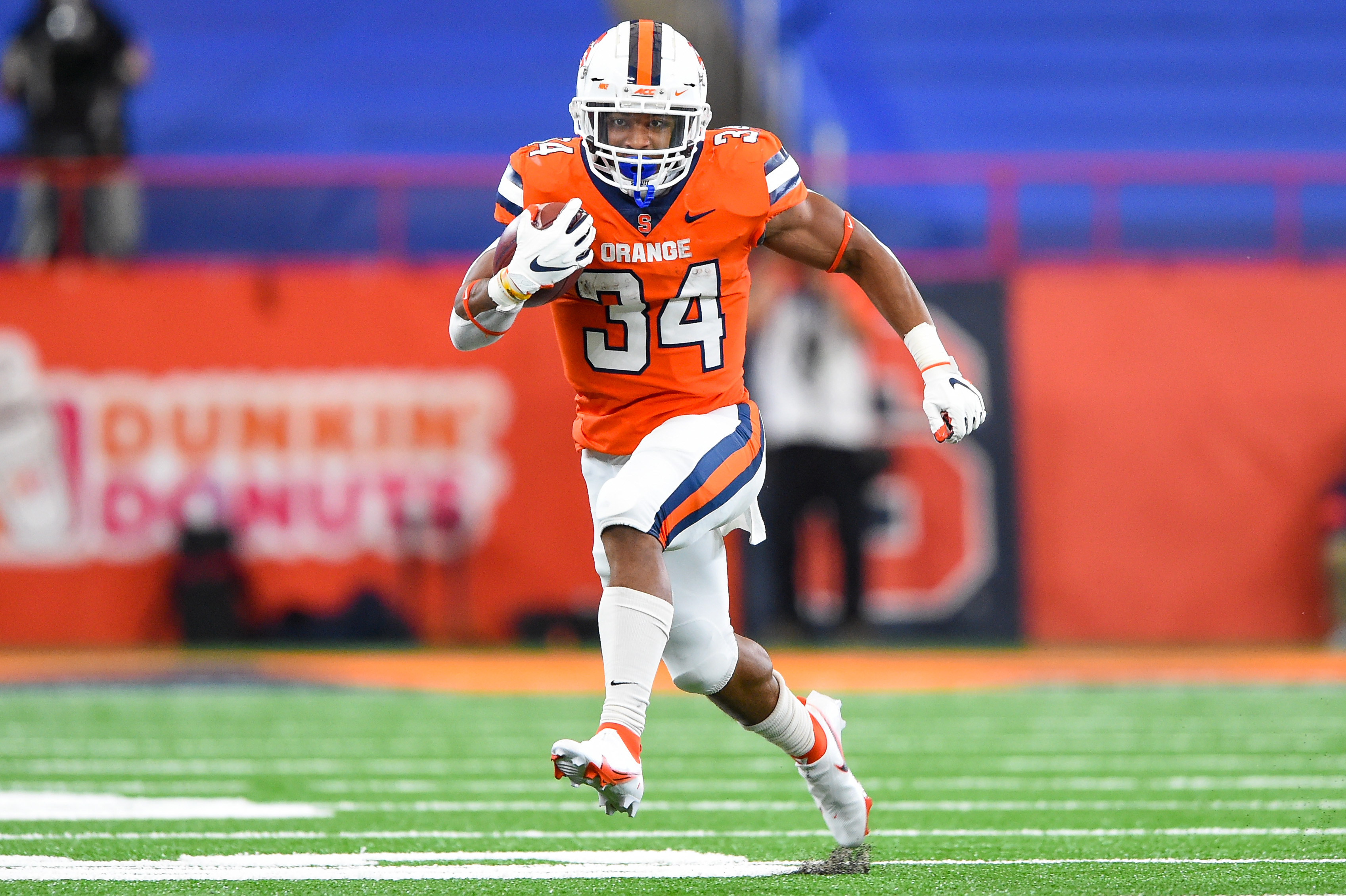Oct 10, 2020; Syracuse, New York, USA; Syracuse Orange running back Sean Tucker (34) runs with the ball against the Duke Blue Devils during the second quarter at the Carrier Dome. Mandatory Credit: Rich Barnes-USA TODAY Sports