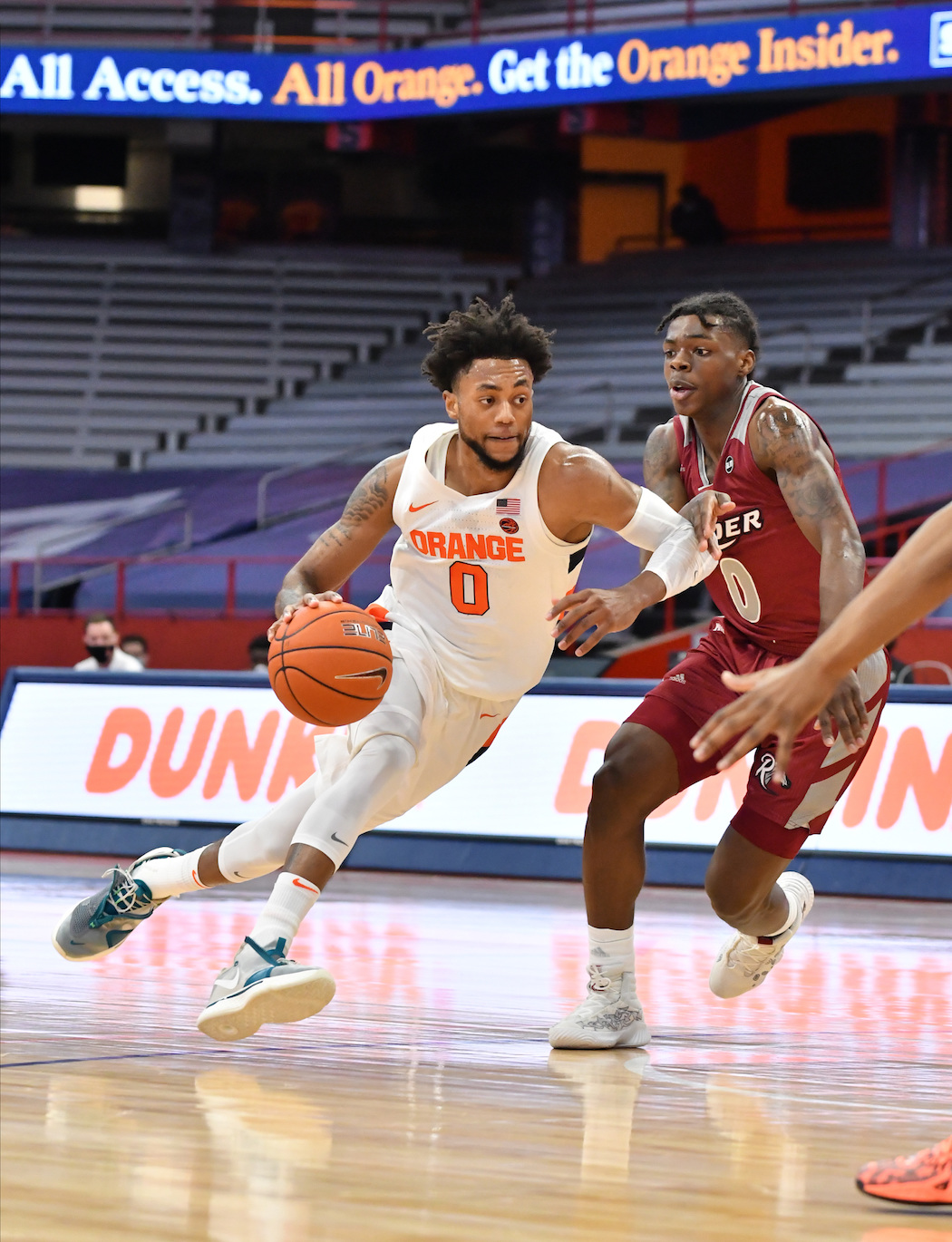 Dec 5, 2020; Syracuse, New York, USA; Syracuse Orange forward Alan Griffin (left) drives to the basket as Rider Broncs guard Christian Ings (right) defends in the first half at the Carrier Dome. Mandatory Credit: Mark Konezny-USA TODAY Sports