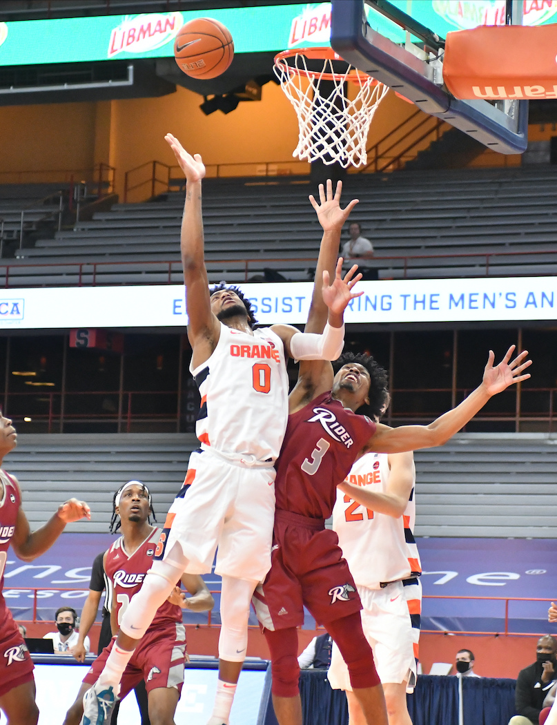 Dec 5, 2020; Syracuse, New York, USA; Syracuse Orange forward Alan Griffin (0) puyts up a shot near the basket as Rider Broncs guard Rodney Henderson Jr. (3) defends in the first half at the Carrier Dome. Mandatory Credit: Mark Konezny-USA TODAY Sports