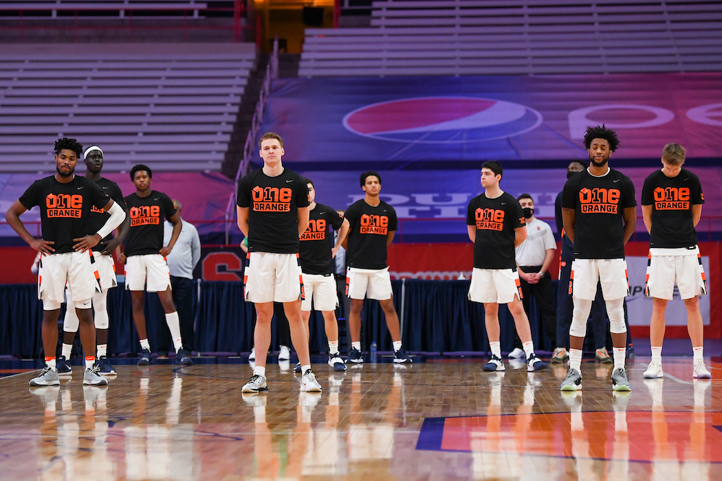 Syracuse players stretch and warm up before playing Pittsburgh earlier in the season.