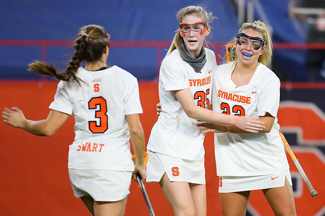 Emily Ehle and Syracuse teammates.