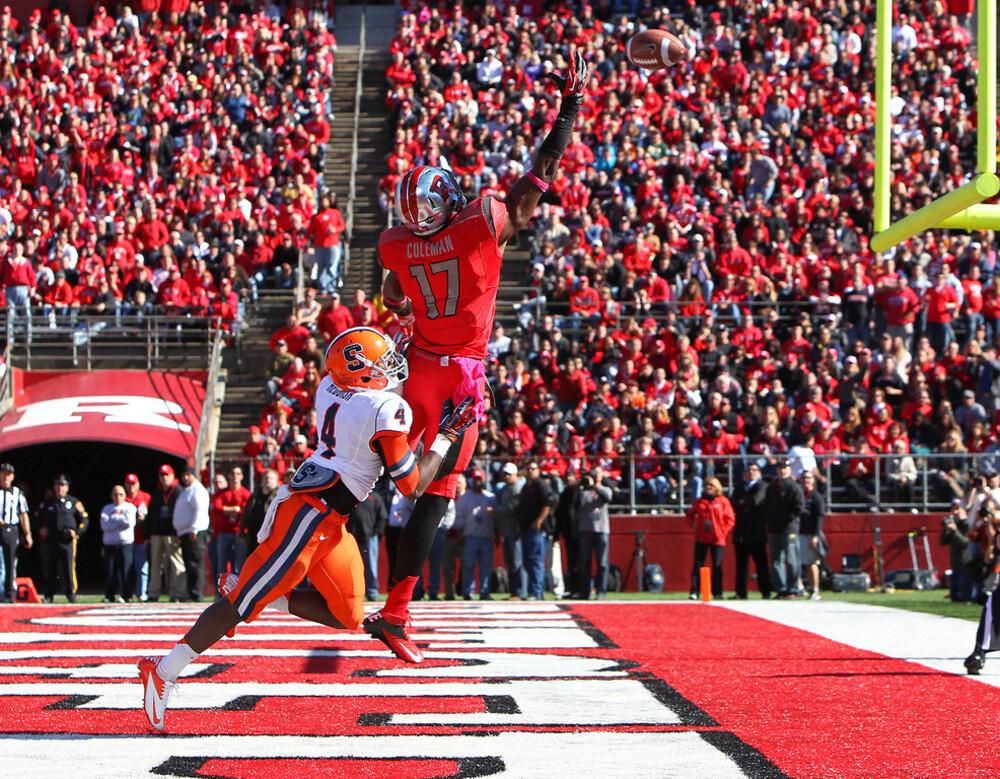 A Rutgers player catches a touchdown pass.