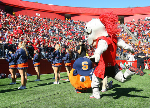 The Rutgers and Syracuse mascots fight.